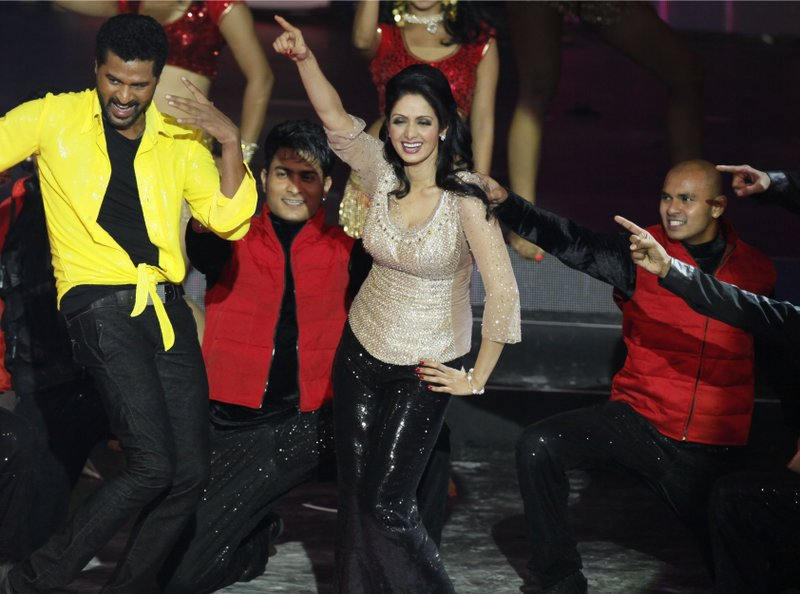 This July 6, 2013 file photo shows Bollywood actors Sridevi, center, and Prabhu Deva, left in yellow, performing during the International Indian Film Academy (IIFA) awards in Macau. Sridevi, Bollywood's leading lady of the 1980s and '90s who redefined stardom for actresses in India, has died at age 54. The actress, known by one name, was described as the first female superstar in India's male-dominated film industry. Her brother-in-law Sanjay Kapoor speaking to the Indian Express online confirmed she died Saturday, Feb. 24, 2018, in Dubai due to cardiac arrest.