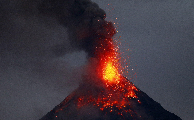 Philippine volcano spews lava fountains, 56,000 people flee