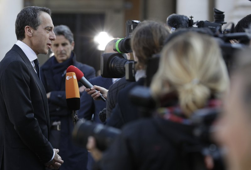 Austrian Chancellor Christian Kern speaks with the media as he arrives for an EU summit at the Palazzo dei Conservatori in Rome on Saturday, March 25, 2017. EU leaders gather in Rome on Saturday to celebrate the 60th anniversary of the EU's founding treaty.