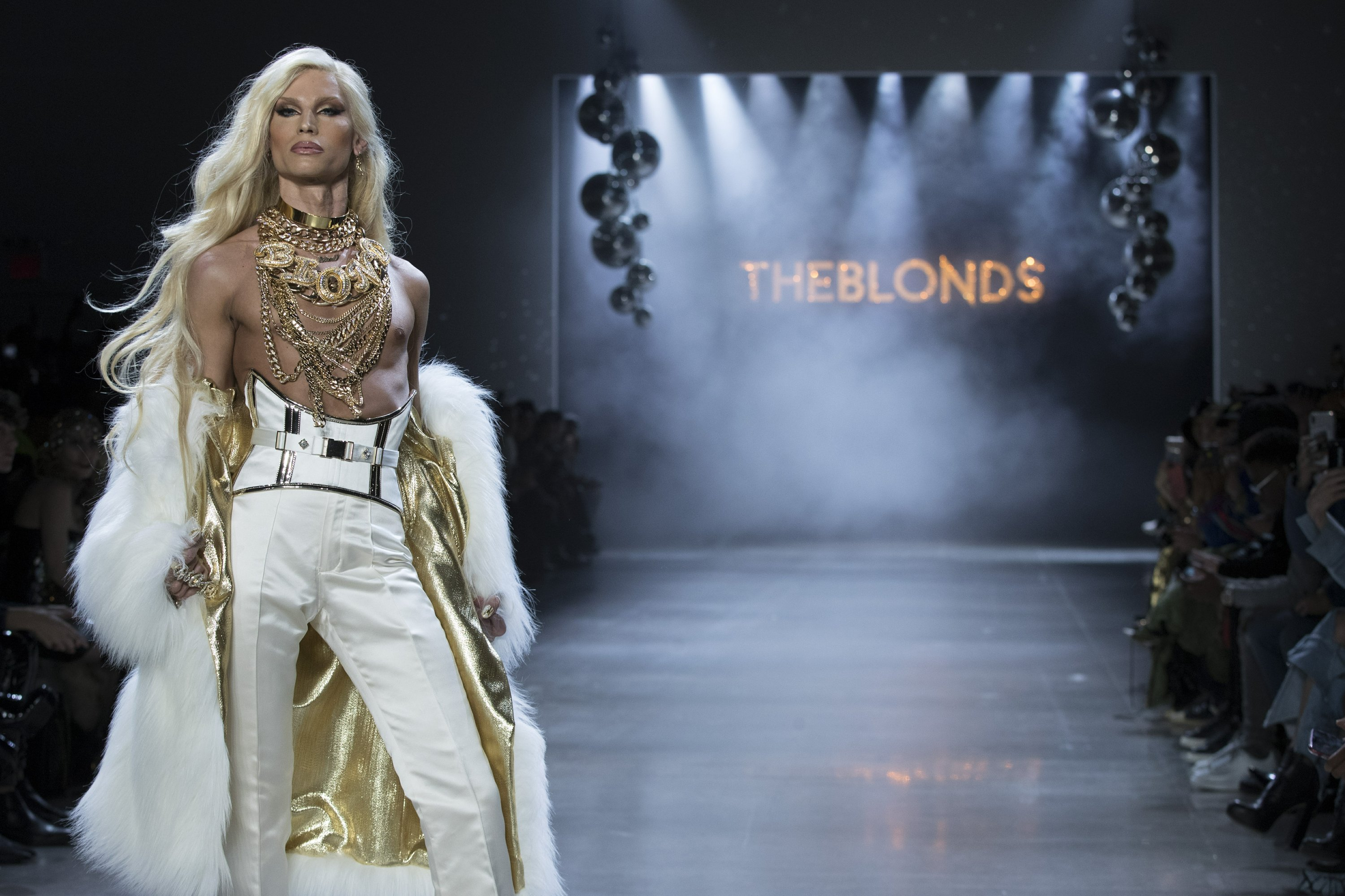 Lil' Kim struts and sings at The Blonds' saucy fashion show