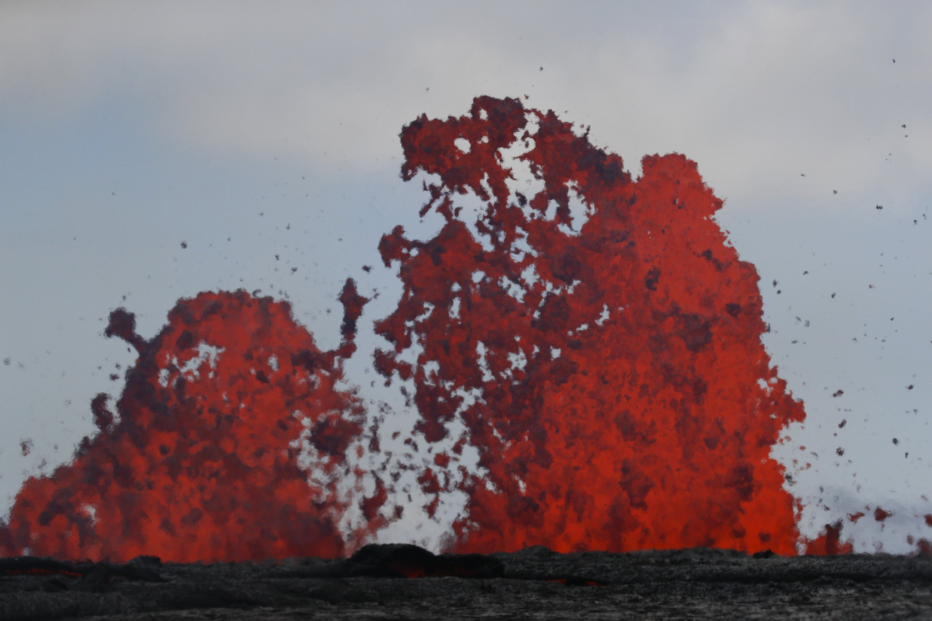 Workers plugging energy wells as lava flows nearby