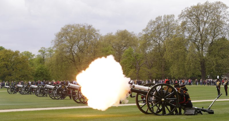 Members of the King's Troop Royal Horse Artillery fire First World War era 13-pounder field guns as part of a 41 gun salute in Hyde Park to mark Britain's Queen Elizabeth II 's 91st birthday, in London, Friday, April 21, 2017.