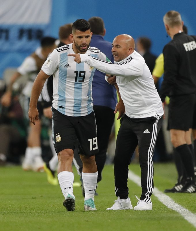 Argentina coach Jorge Sampaoli gestures with Sergio Aguero during the group D match between Argentina and Nigeria, at the 2018 soccer World Cup in the St. Petersburg Stadium in St. Petersburg, Russia, Tuesday, June 26, 2018.