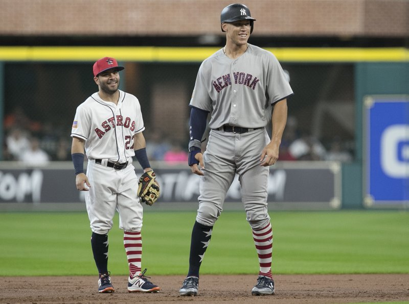 New York Yankees Aaron Judge Right And Houston Astros Second Baseman Jose Altuve Have A Conversation During The First Inning Of Baseball