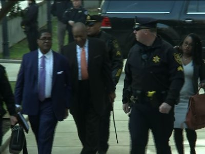Cosby Arrives Amid Heightened Security