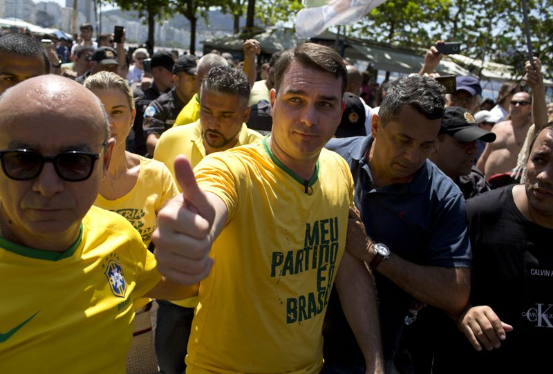 Backers of Brazil candidate in 1st rally after knife attack