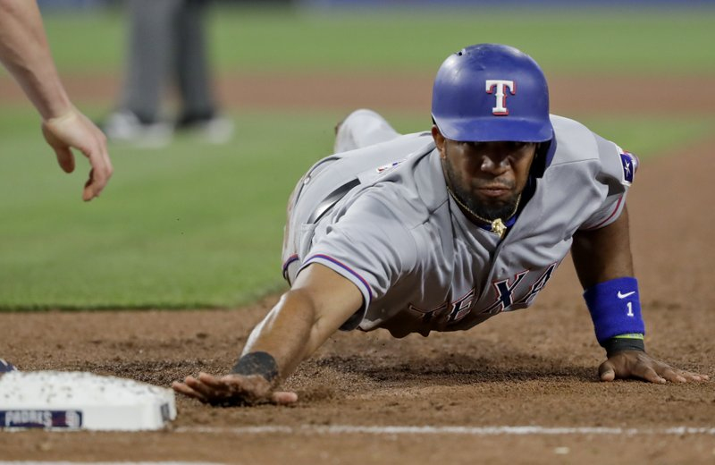 Texas Rangers' Elvis Andrus gets back to first base during the fourth inning of a baseball game Monday, May 8, 2017, in San Diego. The play was overturned upon review. (AP Photo/Gregory Bull)