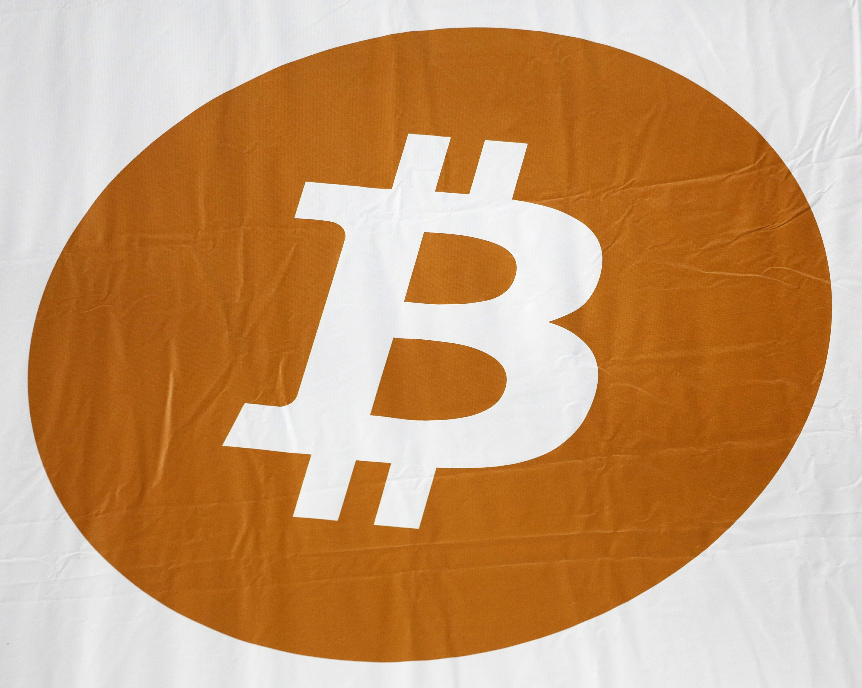 Bitcoin tops $17,000; hack raises concerns ahead of US trade
