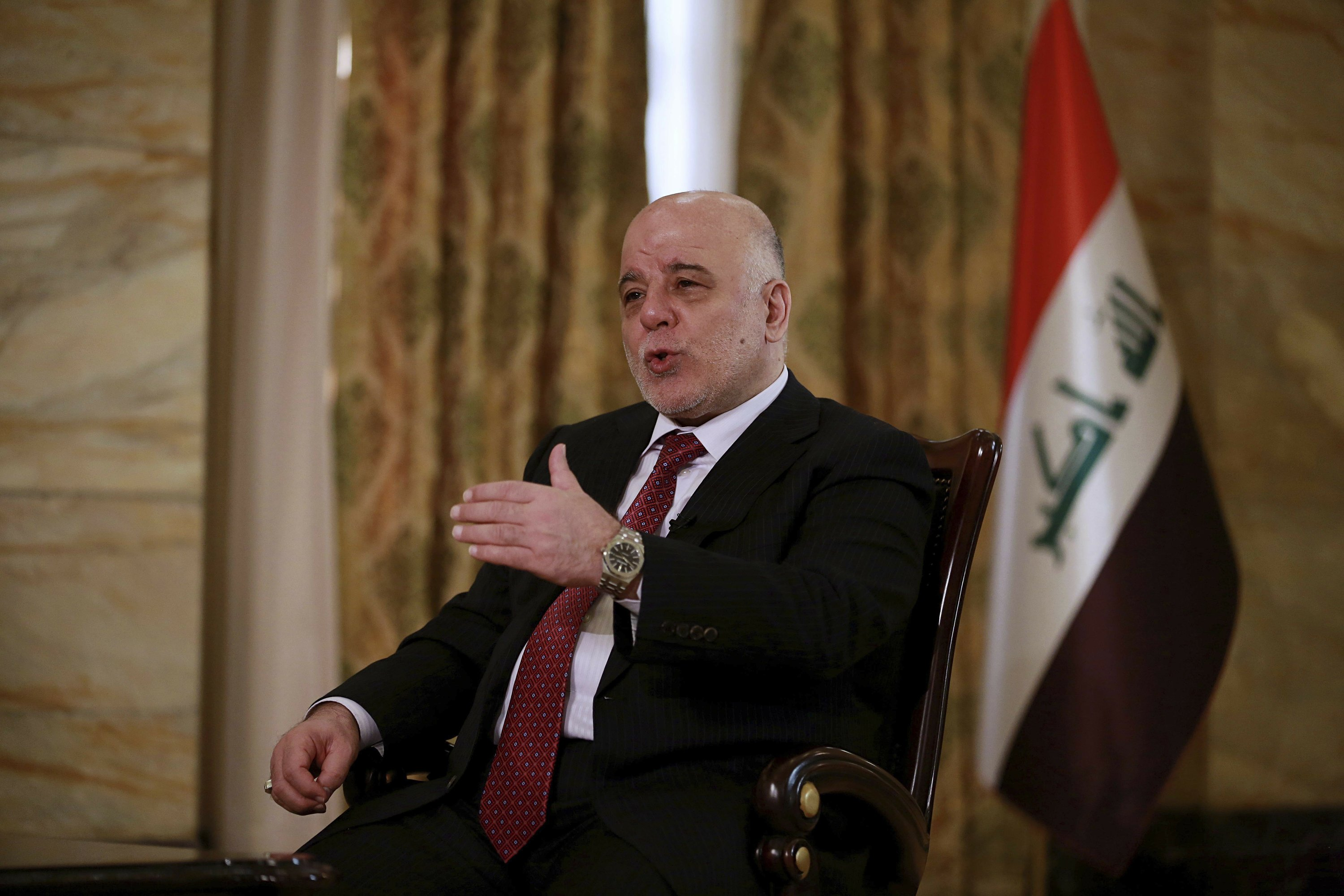 The Latest: Iraq PM says Mosul abuses not systematic