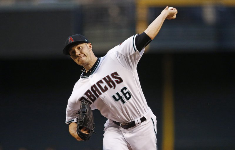 Arizona Diamondbacks' Patrick Corbin throws a pitch against the San Diego Padres during the first inning of a baseball game Tuesday, April 25, 2017, in Phoenix. (AP Photo/Ross D. Franklin)