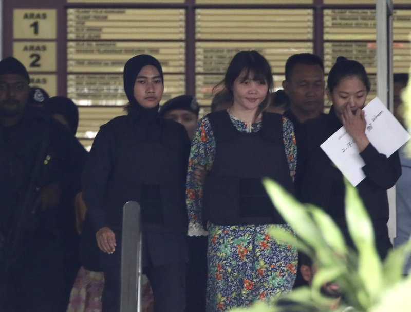 Masks worn in Malaysian court as VX-tainted evidence shown