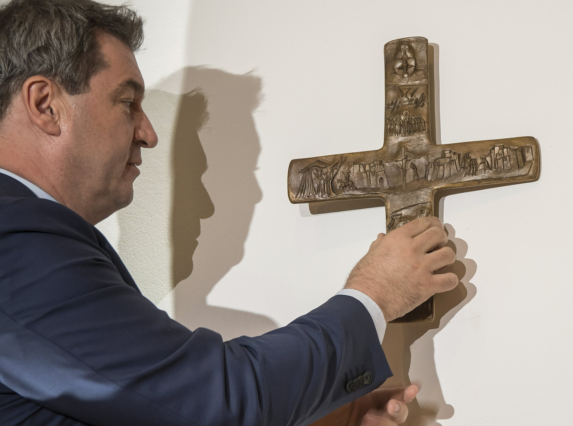 German state orders crosses mounted at government buildings