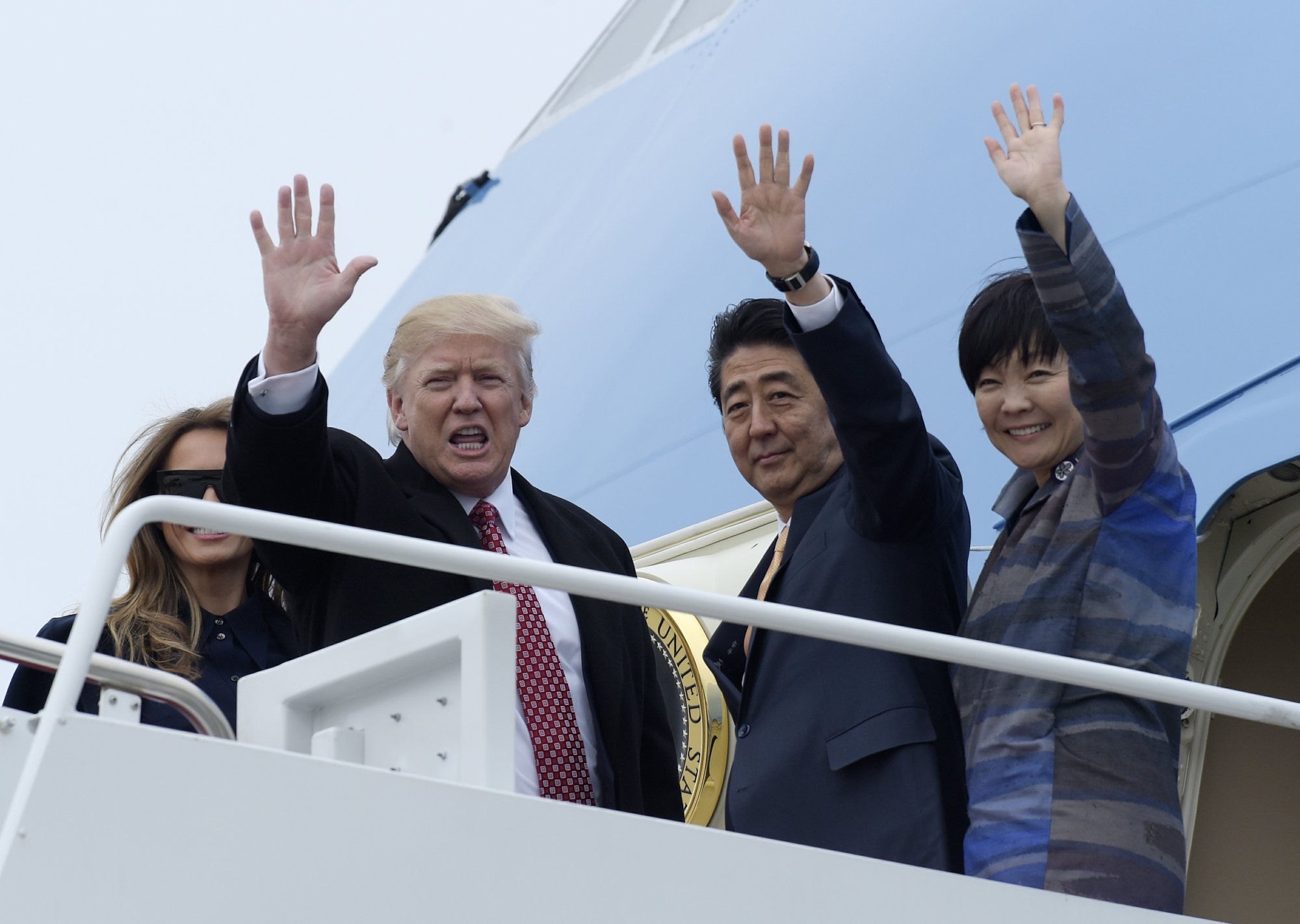Trump hugs ally Japan after easing US-China tensions