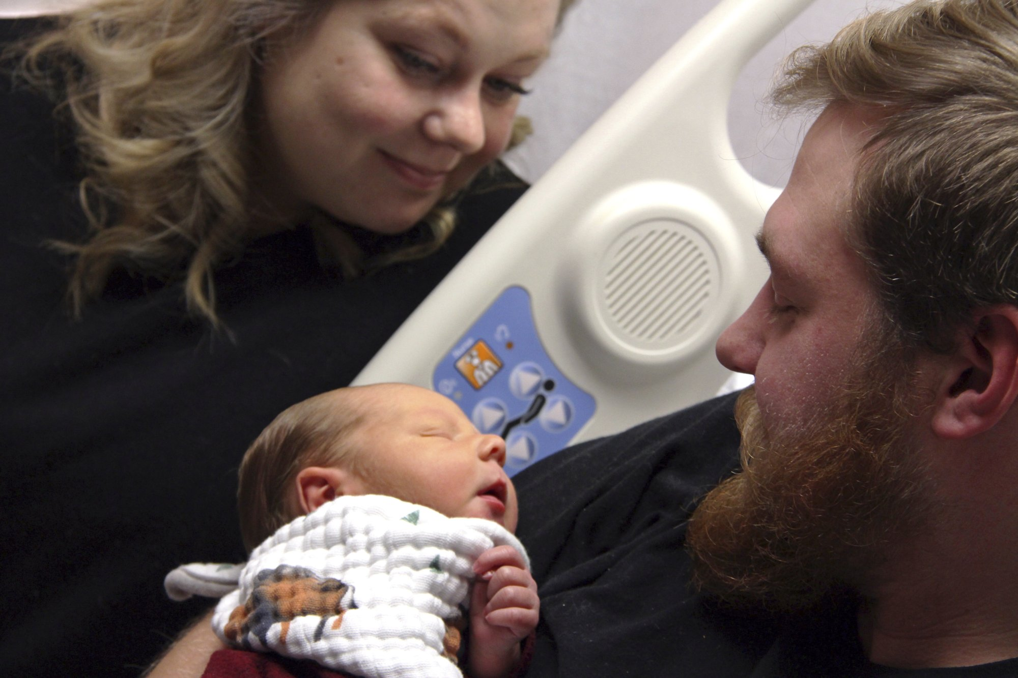 Woman saves husband who emerges from coma to see son's birth