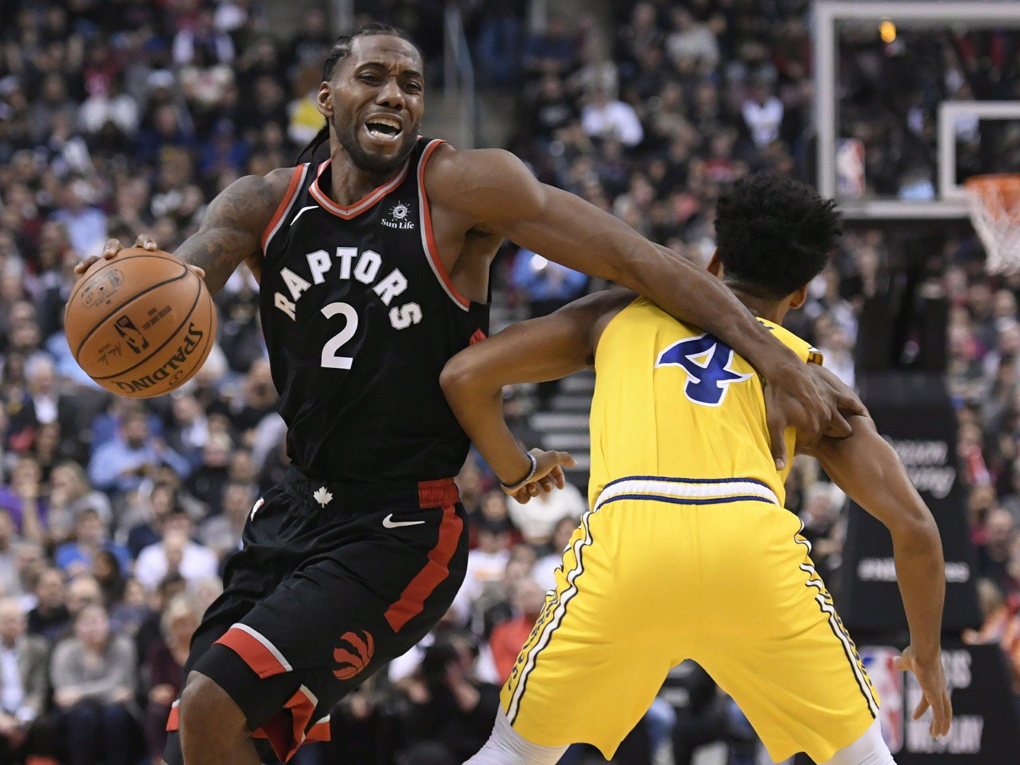 Leonard scores 37, Raptors beat Warriors 131-128 in OT