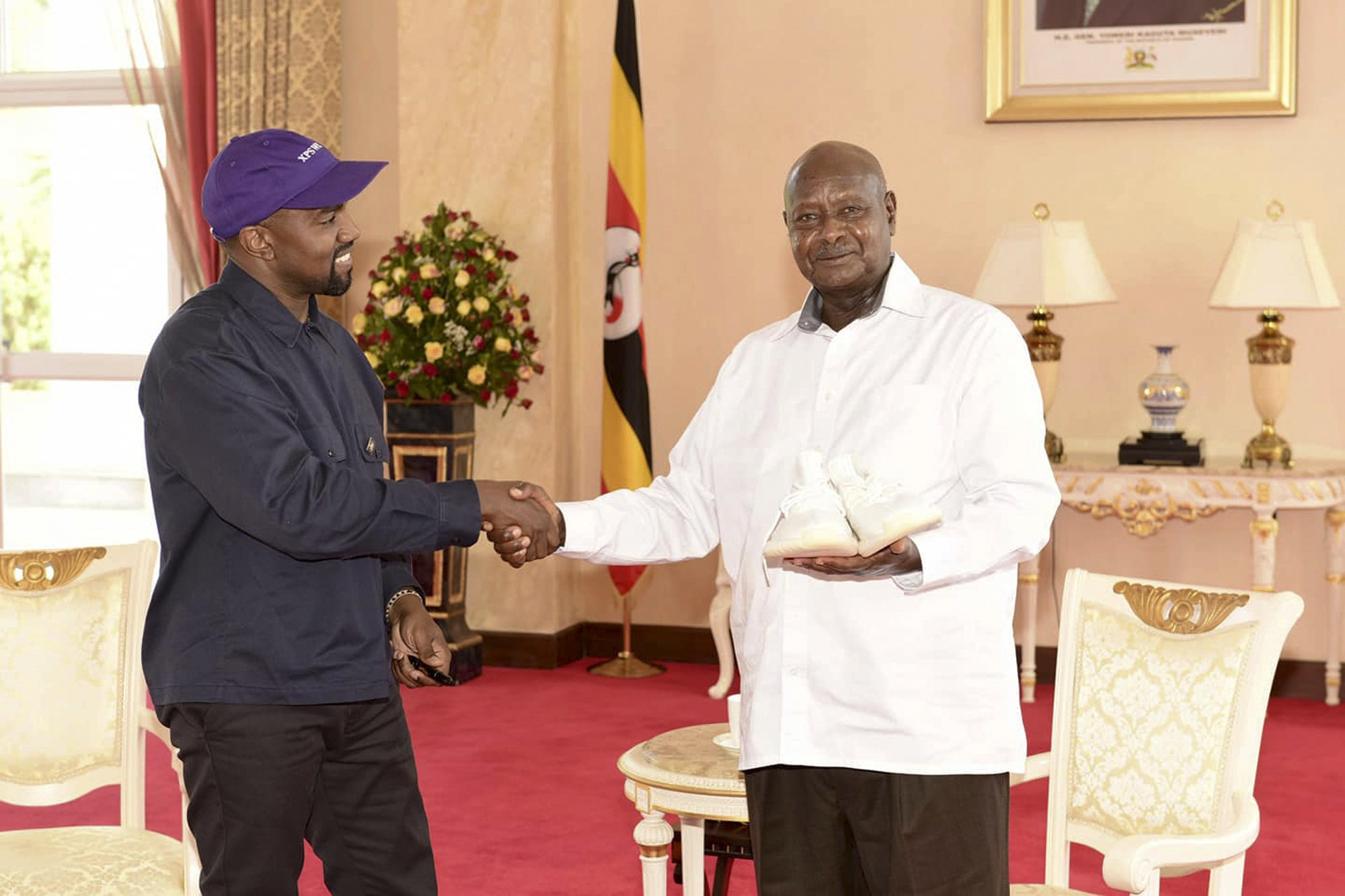 Kanye West meets Ugandas president, gifts pair of sneakers images