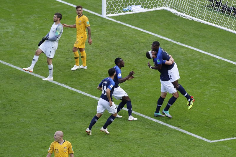 France's Paul Pogba, right, celebrates scoring his side's second goal during the group C match between France and Australia at the 2018 soccer World Cup in the Kazan Arena in Kazan, Russia, Saturday, June 16, 2018.