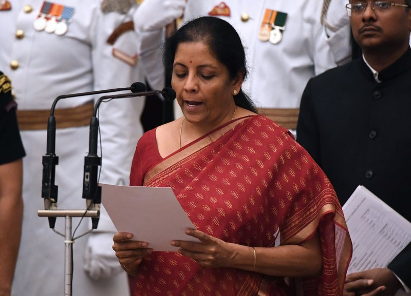 Bharatiya Janata Party (BJP) politician and member of parliament Nirmala Sitharaman takes the oath during the swearing-in ceremony of new ministers at the Presidential Palace in New Delhi, India, Sunday, Sept.3, 2017. India Prime Minister Narendra Modi, on Sunday reshuffled some of his key minister's portfolios to refurbish his government's image, which has been dented by falling economic indicators.