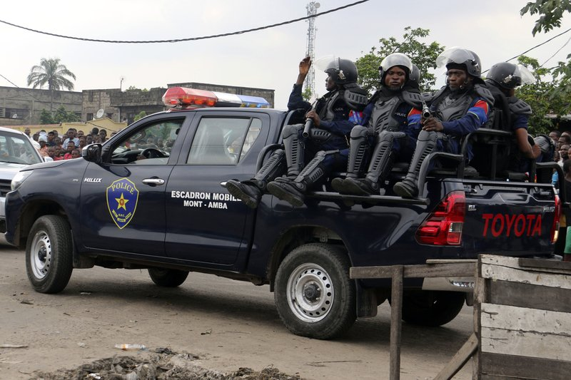 Congolese police patrol outside the main prison in Kinshasa, Congo, Wednesday May 17, 2017. Christian sect members stormed a prison in Congo's capital Wednesday, freeing the leader of their movement and 50 others, Congo's justice minister said. Bundu dia Kongo movement leader Ne Mwanda Nsemi is now on the run after a 4 a.m. attack on Malaka prison in Kinshasa, Justice Minister Alexis Thambwe Mwamba told local radio station Top Congo FM.