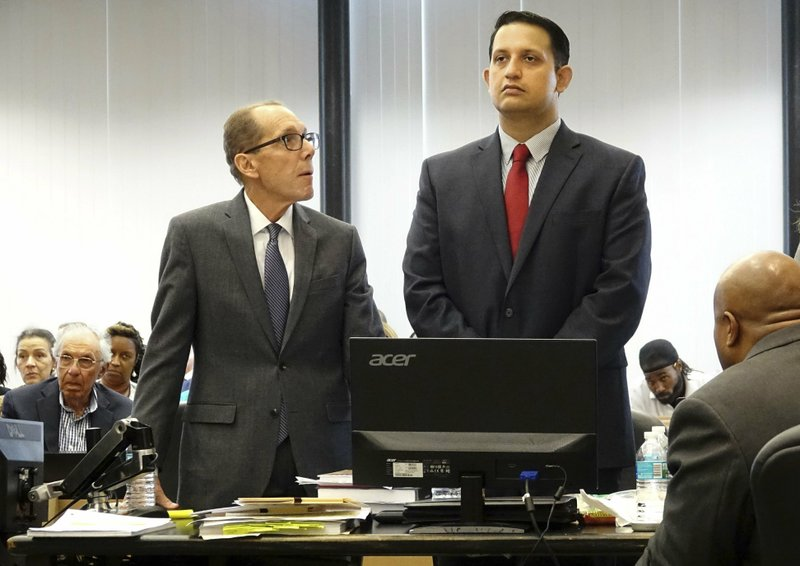 The Latest: Defense: Motorist's shooting death not a crime