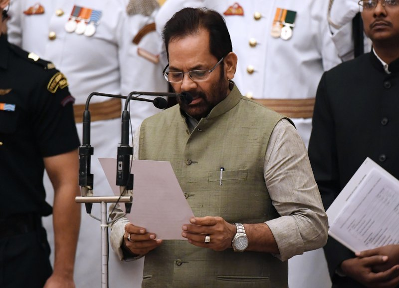 Bharatiya Janata Party (BJP) politician and member of parliament Mukhtar Abbas Naqvi takes the oath during the swearing-in ceremony of new ministers at the Presidential Palace in New Delhi, India, Sunday, Sept.3, 2017. India Prime Minister Narendra Modi, on Sunday reshuffled some of his key minister's portfolios to refurbish his government's image, which has been dented by falling economic indicators.