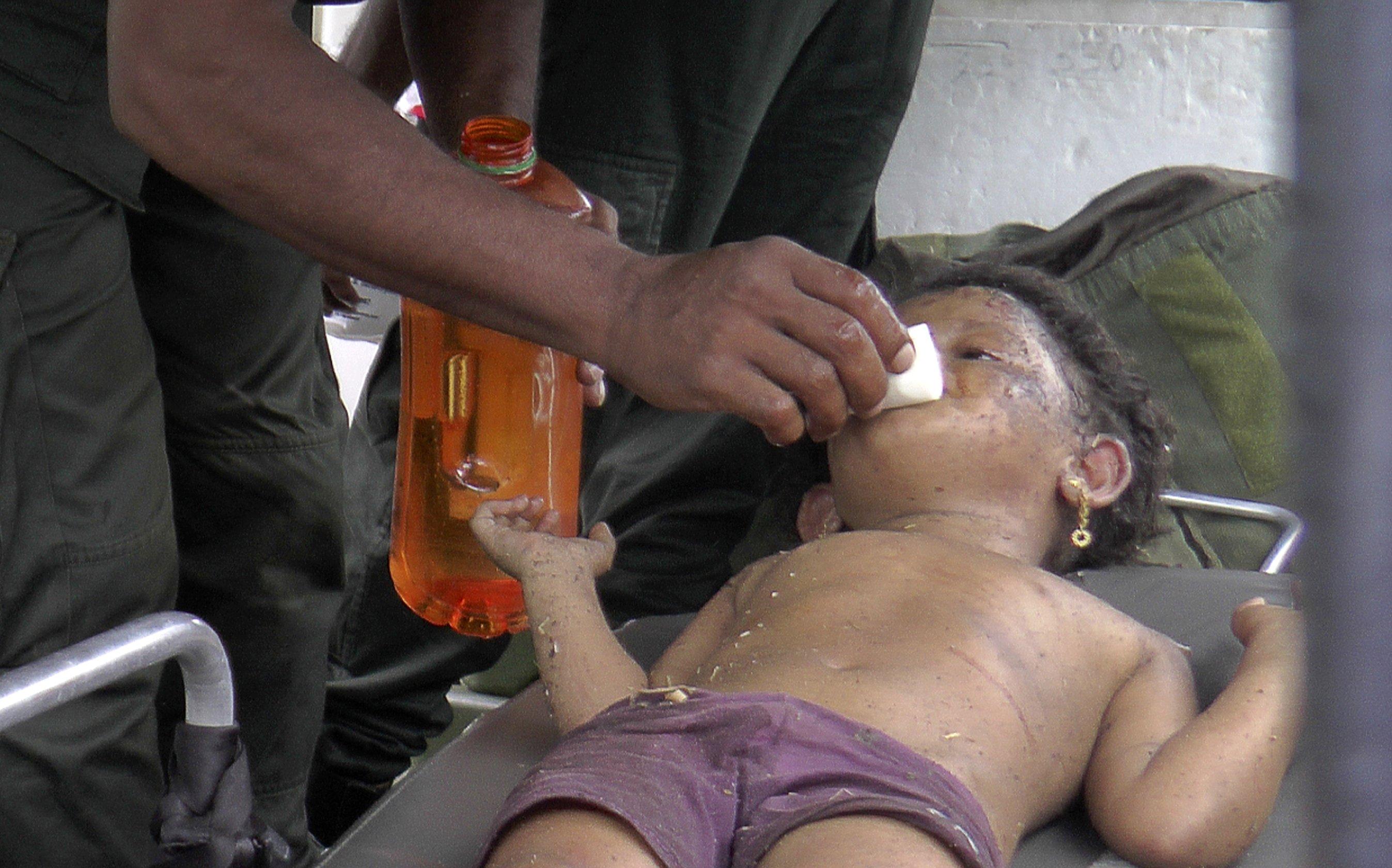Sri Lanka militants set off bombs during raid, killing 15
