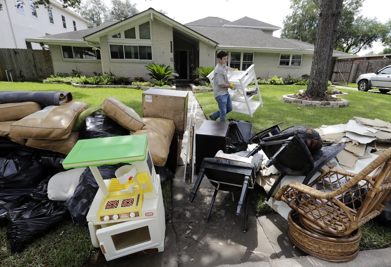 Houston Christmas Tree Pickup Part - 17: Steven Reinitz Helps Remove Items Damaged By Floodwaters From Tropical  Storm Harvey From His Parents Home Wednesday, Aug. 30, 2017, In Houston.