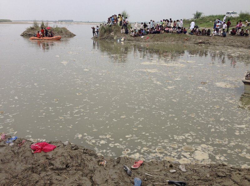 Villagers gather at the spot of a boat capsize as rescuers search in the Yamuna River near Baghpat town in Uttar Pradesh state, India, Thursday, Sept.14, 2017. A boat crowded with construction workers capsized in the Yamuna River early Thursday and nineteen bodies have been pulled out of the river so far.