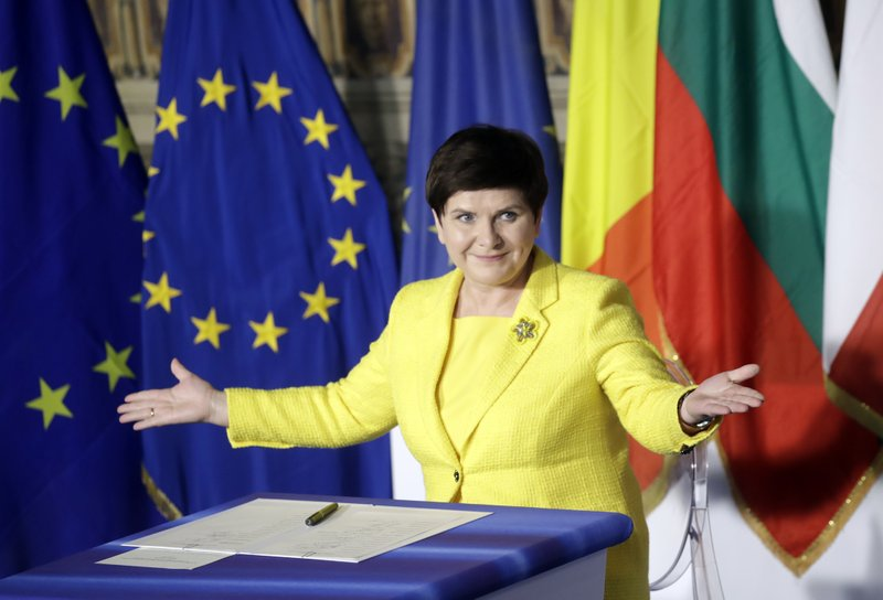 Polish Prime Minister Beata Szydto gestures after signing a declaration during an EU summit meeting at the Orazi and Curiazi Hall in the Palazzo dei Conservatori in Rome on Saturday, March 25, 2017. European Union leaders were gathering in Rome to mark the 60th anniversary of their founding treaty and chart a way ahead following the decision of Britain to leave the 28-nation bloc.