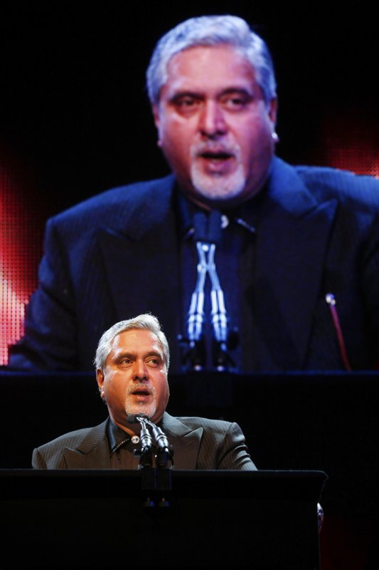 In this October 26, 2010 file photo, Indian entrepreneur Vijay Mallya receives the Entrepreneur Of The Year Award at The Asian Awards at Grosvenor House Hotel, Park Lane, London. India's top court on Tuesday, May 9, 2017, found wanted tycoon Mallya guilty of disobeying its order barring him from transferring $40 million to his children. Mallya, who fled to London last year, is wanted in India on charges of money laundering and bank demands that he pay back more than a billion dollars in loans extended to his now-defunct airline. India has been seeking his extradition over the charges, which Mallya denies.