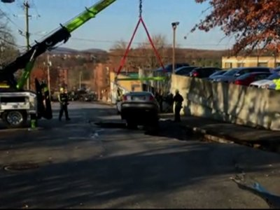 Car Swallowed By Manchester, NH Sinkhole