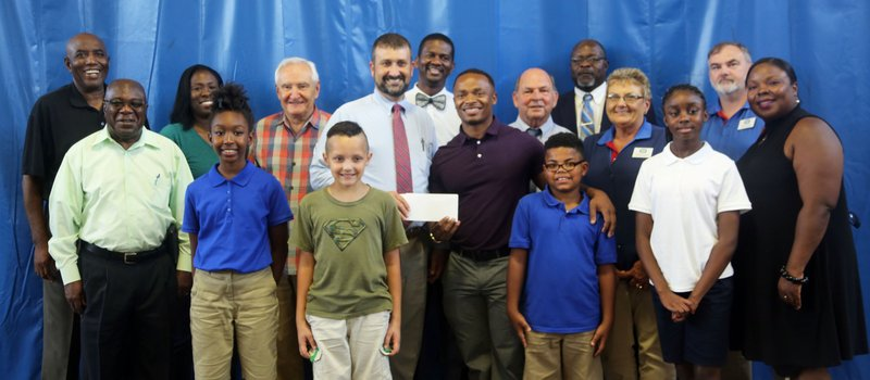 W. Lee Flowers and Co. donated $10,000 Tuesday afternoon to the Lake City Boys & Girls Club.