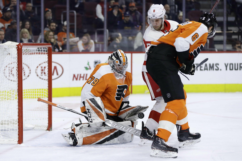 3335d5d97 Hart stops 20 shots in NHL debut