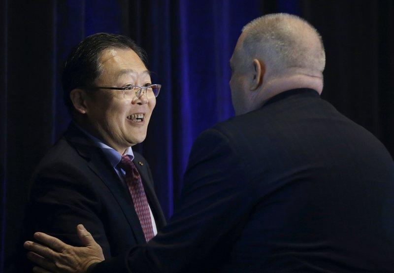 Xu Chen, Larry Hogan