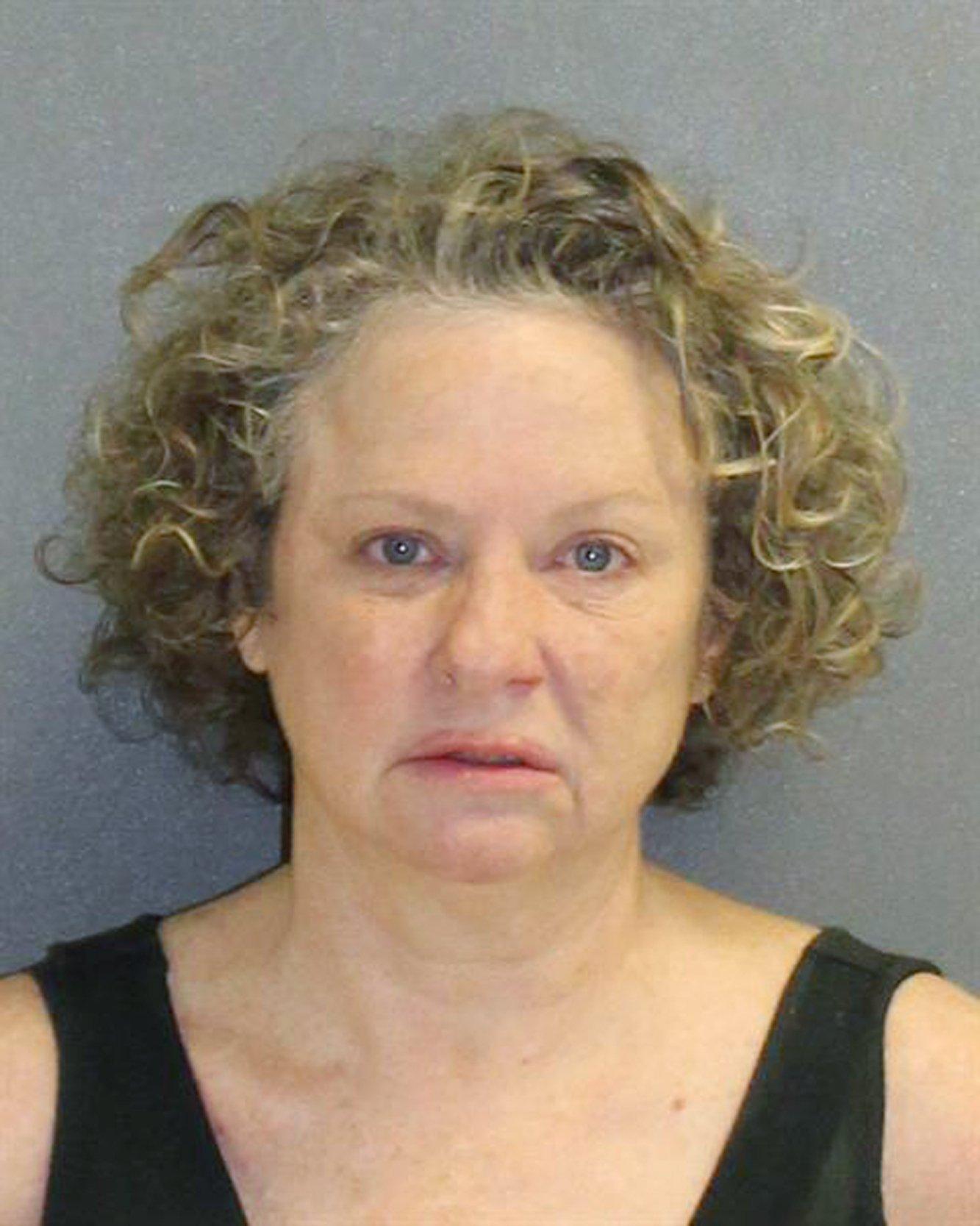 White woman threatens black deputy with KKK during arrest