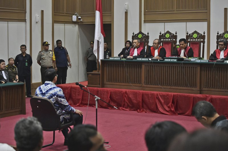 "Jakarta Governor Basuki ""Ahok"" Tjahaja Purnama sits on the defendant's chair as he attends his sentencing hearing in Jakarta, Indonesia, Tuesday, May 9, 2017. The minority Christian governor is currently on trial on accusation of blasphemy following his remark about a passage in the Quran that could be interpreted as prohibiting Muslims from accepting non-Muslims as leaders."