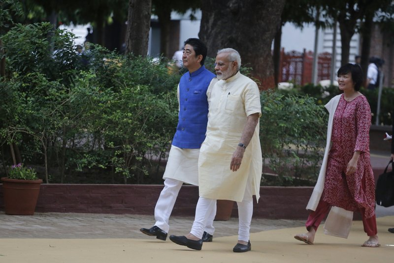 Japanese Prime Minister Shinzo Abe, left, his wife Akie Abe, and Indian Prime Minister Narendra Modi walk inside Sabarmati Ashram, or Gandhi Ashram, in Ahmadabad, India, Wednesday, Sept. 13, 2017. Abe is on a two-day official visit to India.