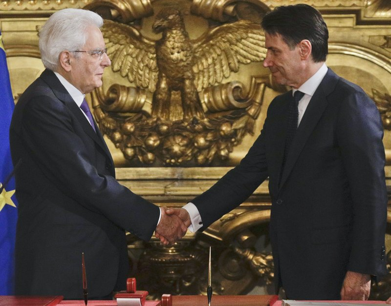 Populists take power in italy with euro skeptic agenda italian president sergio mattarella left shakes hands with premier giuseppe conte during the swearing in ceremony for italys new government at romes m4hsunfo