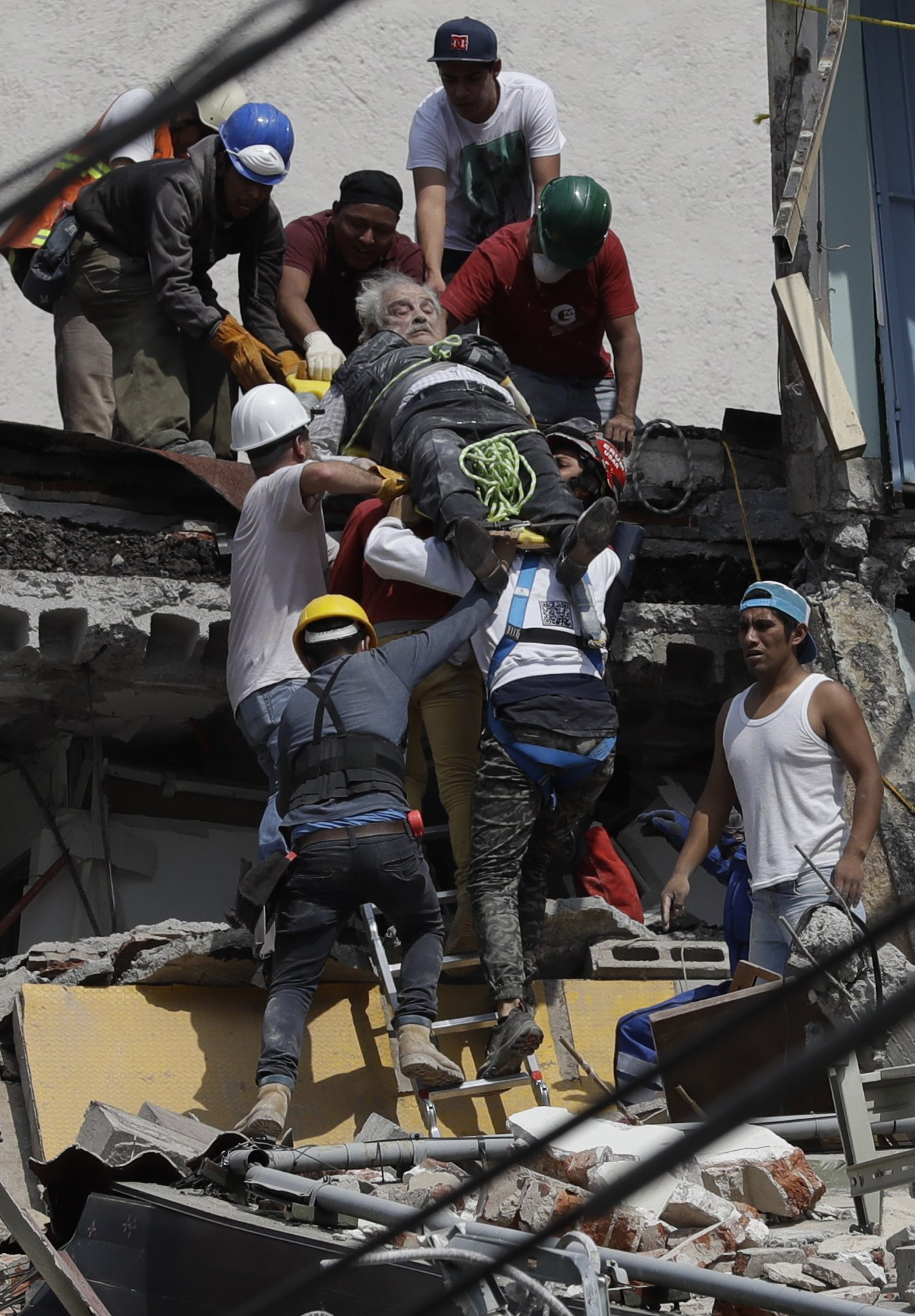 The Latest: Mexico City rescuers pull woman from rubble