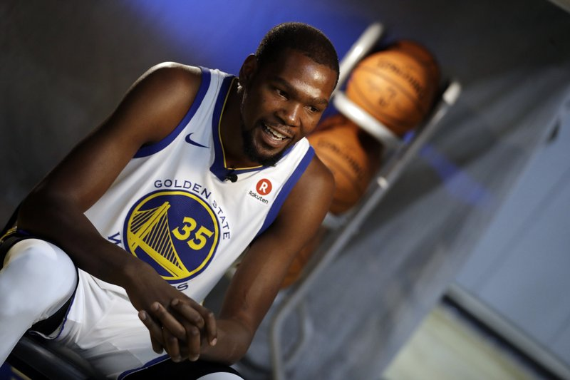 522806fa9818 Golden State Warriors  Kevin Durant conducts an interview during NBA  basketball team media day Friday