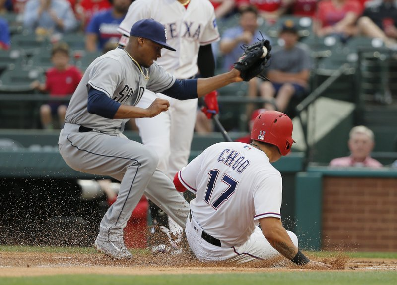 Texas Rangers designated hitter Shin-Soo Choo (17) scores on a wild pitch as San Diego Padres pitcher Luis Perdomo (61) tries to make the tag during the first inning of a baseball game, Wednesday, May 10, 2017, in Arlington, Texas. (AP Photo/Tony Gutierrez)
