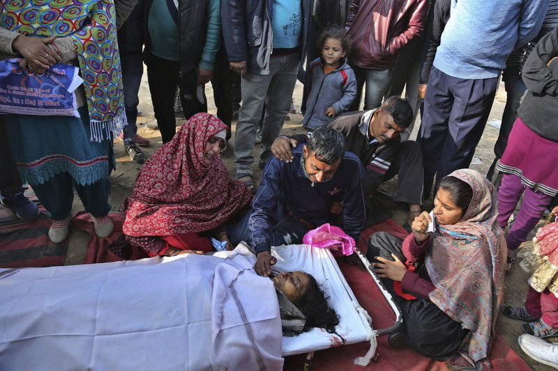 Relatives of Indian woman Bachno Devi, who was killed in Pakistani firing and shelling, wail near her body at a hospital in Ranbir Singh Pura district of Jammu and Kashmir, India, Friday, Jan.19,2018. Tensions soared along the volatile frontier between India and Pakistan in the disputed Himalayan region of Kashmir as soldiers of the rivals continued shelling villages and border posts for third day Friday.