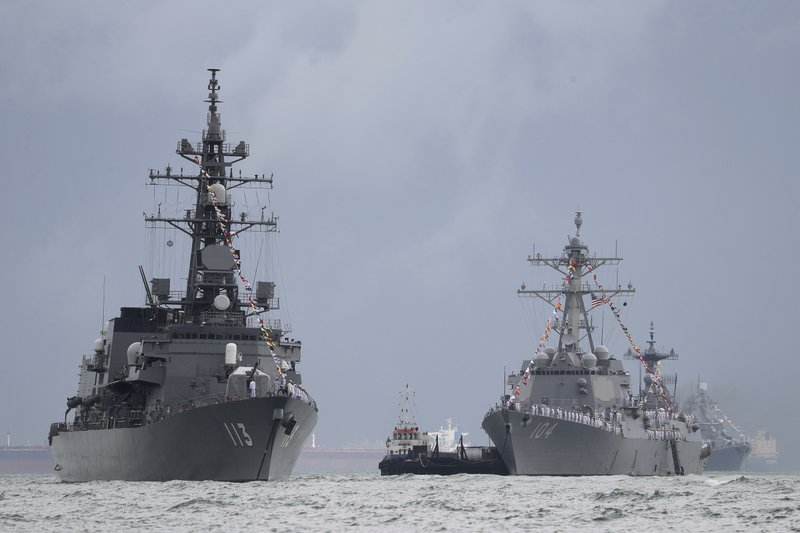 In this Monday, May 15, 2017, photo, Japan's destroyer JS Sazanami, left, the United States' Arleigh Burke-class guided missile destroyer USS Sterett, center, and South Korean destroyer ROKS Dae Jo Yeong, right rear, are anchored in the waters off RSS Singapura Changi Naval Base in Singapore. As part of the Republic of Singapore Navy's 50th anniversary celebrations, 28 foreign warships from 20 countries gathered at the naval base and its surrounding waters to mark the occasion.