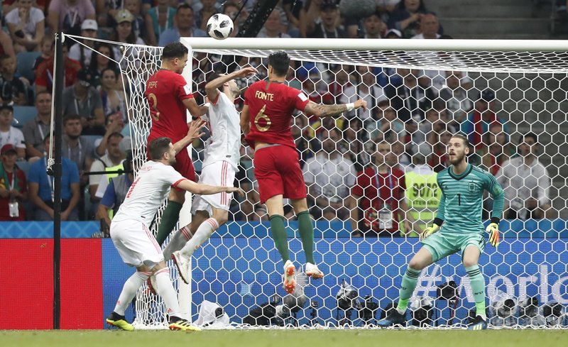 Portugal's Pepe and Portugal's Jose Fonte challenge for the ball in front of Spain goalkeeper David De Gea during the group B match between Portugal and Spain at the 2018 soccer World Cup in the Fisht Stadium in Sochi, Russia, Friday, June 15, 2018.