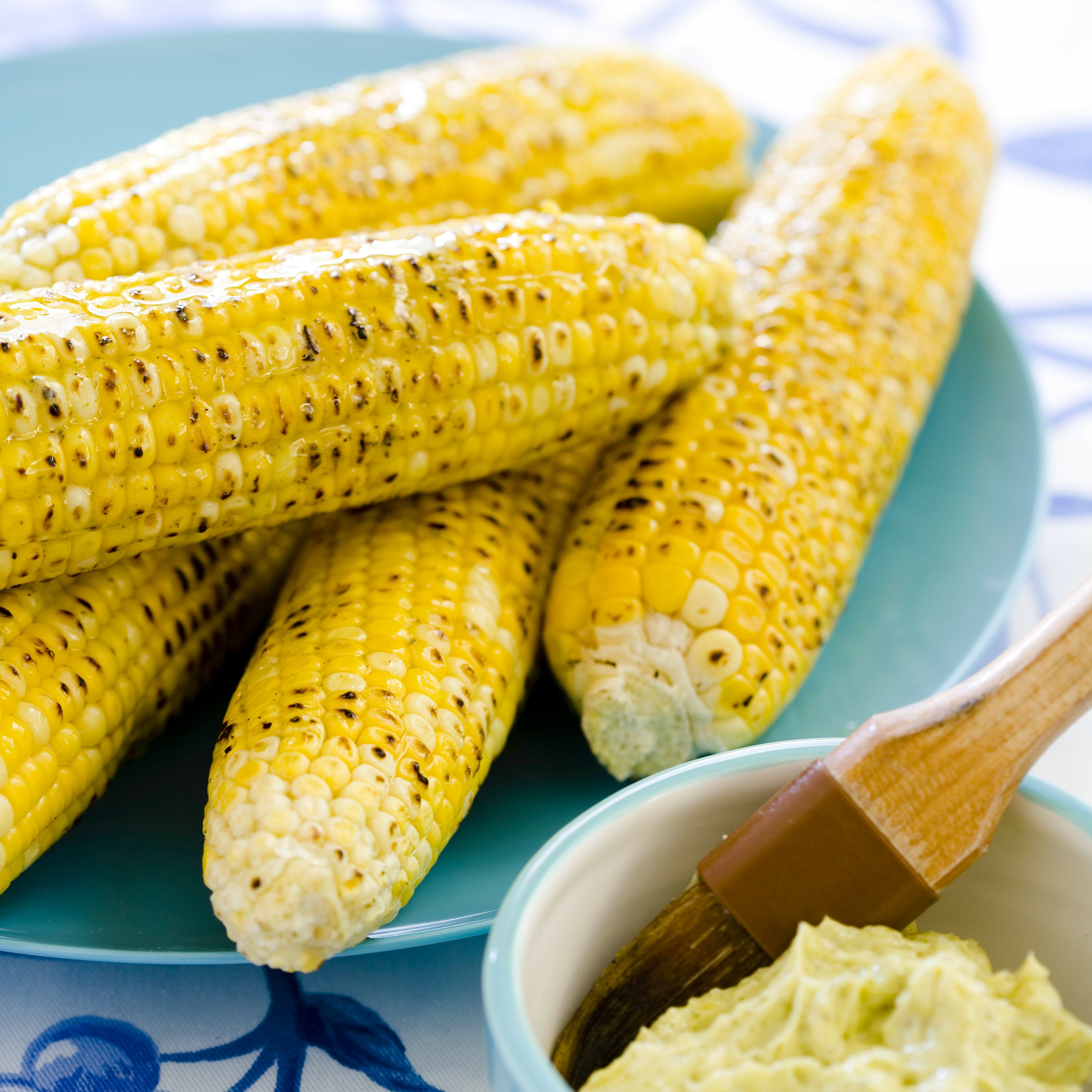 The secret to perfectly grilled corn? Cook them unhusked