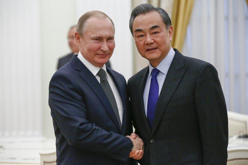 Vladimir Putin, Wang Yi