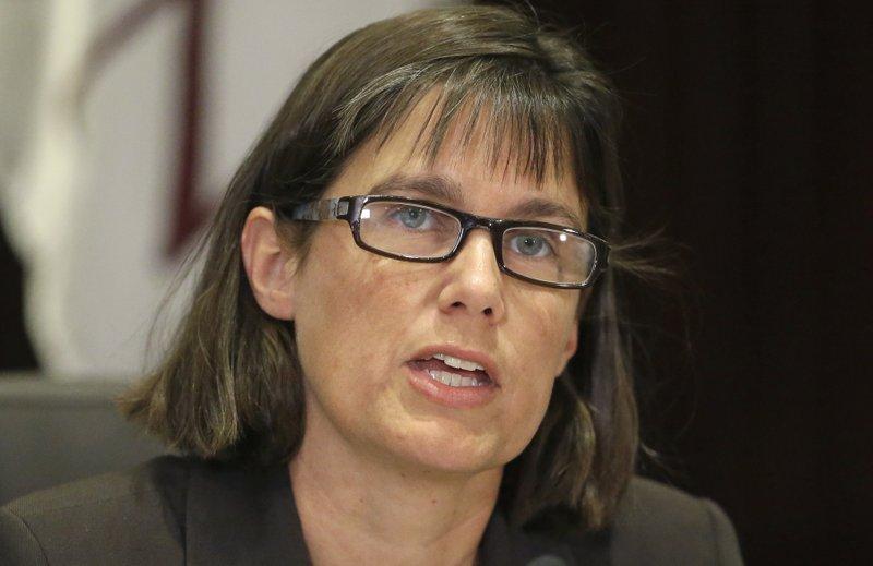 J. Erin Staples
