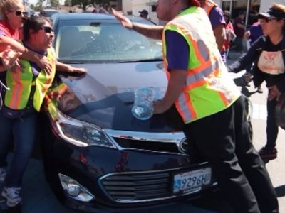 Raw: Man Drives into Crowd at Immigration Rally