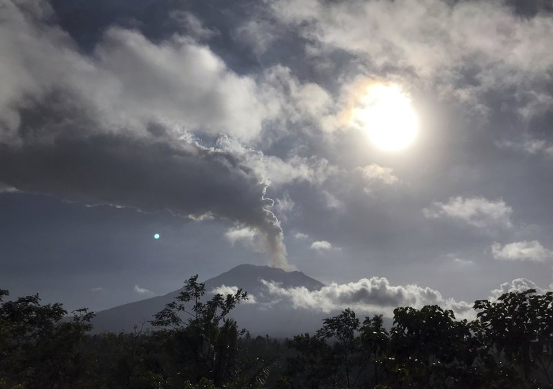Mount Agung volcano spews smoke seen in Karangasem, Bali, Indonesia Friday, June 29, 2018. The Indonesian tourist island of Bali closed its international airport Friday, stranding thousands of travelers, as the Mount Agung volcano gushed a 2,500-meter (8,200-feet) column of ash and smoke.
