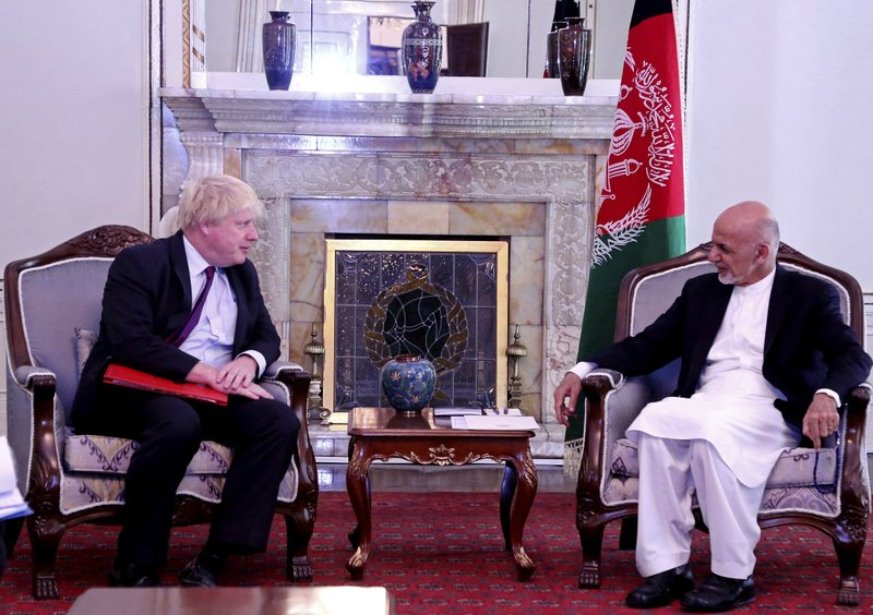 Afghan President Ashraf Ghani, right, meets with British Secretary of State for Foreign Affairs, Boris Johnson, left, at the presidential palace in Kabul, Afghanistan, Monday, June 25 2018. (AP Photo/Arg Presidential Palace)